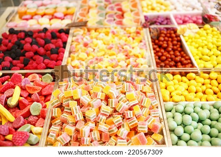 Various jelly candies in candy shop. Sweet food arranged on market/Sweet food  - stock photo