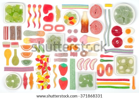 various jelly candies on white background. multicolored flat lay composition - stock photo