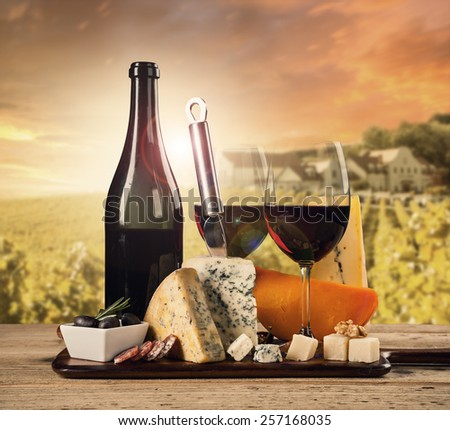 Various kind of cheese with red wine - stock photo