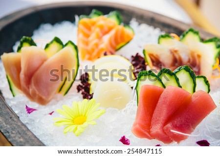 various kind of fresh raw sashimi on ice - stock photo