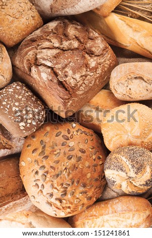 various kinds of bread on pile - stock photo