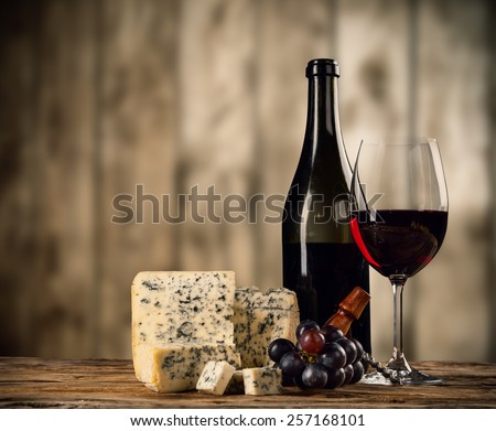 Various kinds of cheese with red wine - stock photo