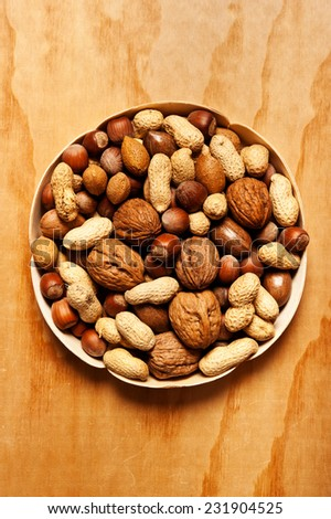 various kinds of nuts with copy space - stock photo