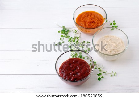Various kinds of sauces on white wooden background horizontal format. - stock photo