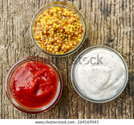 various kinds of sauces on wooden table, top view - stock photo