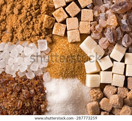Various kinds of sugar closeup background - stock photo