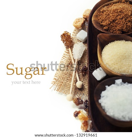 Various kinds of sugar in wooden bowls (with easy removable sample text) - stock photo