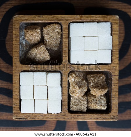 Various kinds of sugar in wooden box - stock photo