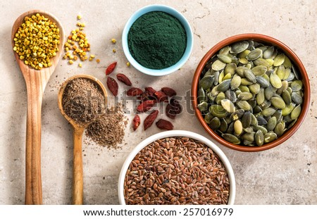 various kinds of superfood on kitchen table for healthy breakfast, top view - stock photo