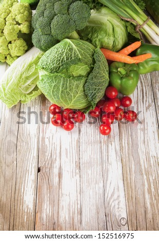 Various kinds of vegetable on wooden desk - stock photo