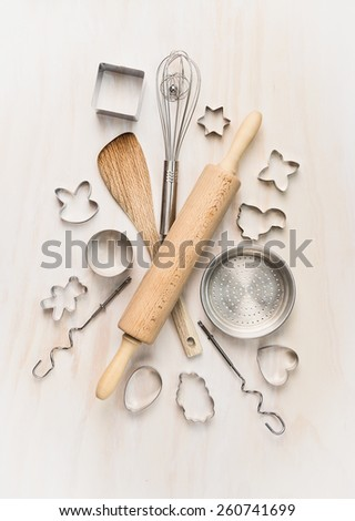 various kitchen bake utensils on white wooden table, top view - stock photo