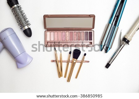 Various makeup products and hairdressing tools on white background,Top view