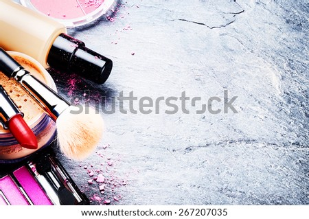 Various makeup products in pink tone with copyspace - stock photo