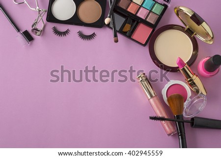 Various makeup products on dark background with copy space,original color tone - stock photo