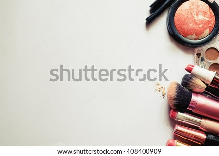 Various makeup products on white background with copy space.vintage tone - stock photo