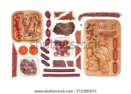 various meat snacks on white background top view. flat lay composition