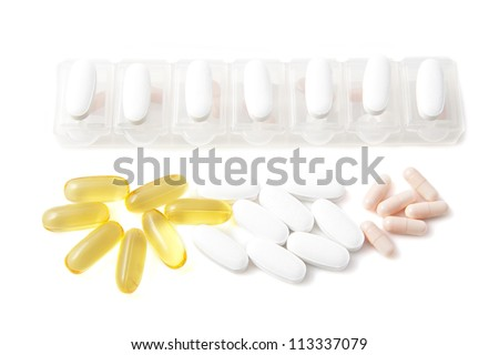Various medications with medication holder isolated over white - stock photo
