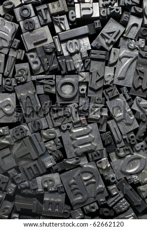 Various metal letter pieces. - stock photo