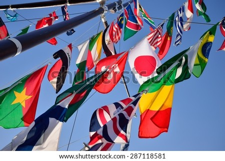 Various national flags against sky