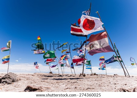 Various nations its flags in the uyuni salt flat in bolivia - stock photo