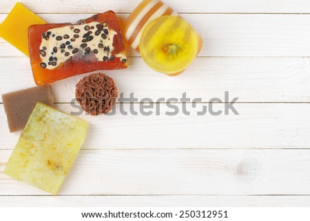 Various natural soaps on white wooden background. Top view point. - stock photo
