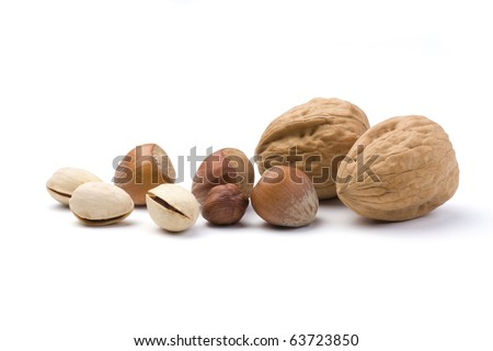 Various nuts collection isolated on a white background. Walnut, Hazelnut and Pistachio.
