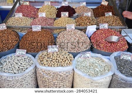 Various Nuts in Bulk Sacks at Farmers Market - stock photo