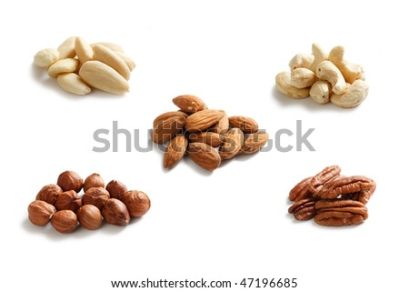 various nuts on white background - stock photo