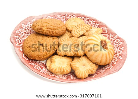 various of cookies on a plate closeup on white