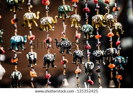 Various of decorative elephants from wood in different colors in Mattancherry Market in Kochi, Kerala, India - stock photo