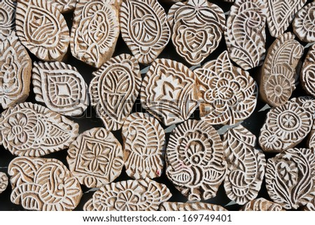 Various of different henna wooden stamps for decorating the body of Indians  - stock photo