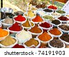 Various of Indian colored powder spices on the Anjuna flea market in India, Goa. - stock