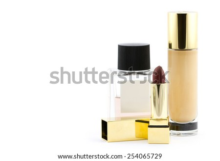 Various of luxury cosmetics: lipstick in gold tube, perfume, beige foundation cream isolated on white background - stock photo