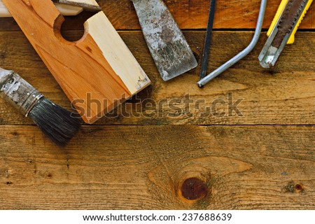 Various old diy tools on rustic wooden work bench - stock photo