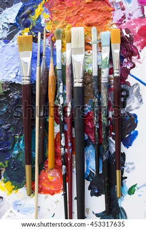 Various Paintbrushes on a Palette. - stock photo