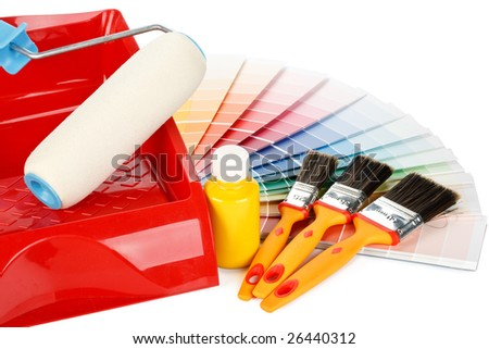 Various painting tools and color guide on a white background - stock photo