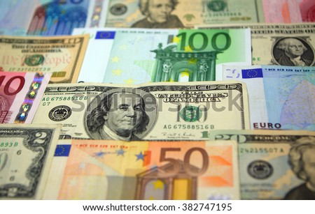 Various paper money euro and dollar banknotes as background - stock photo