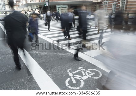 Various people image slow shutter series coming and going Tokyo Station Marunouchi business district of Tokyo - stock photo