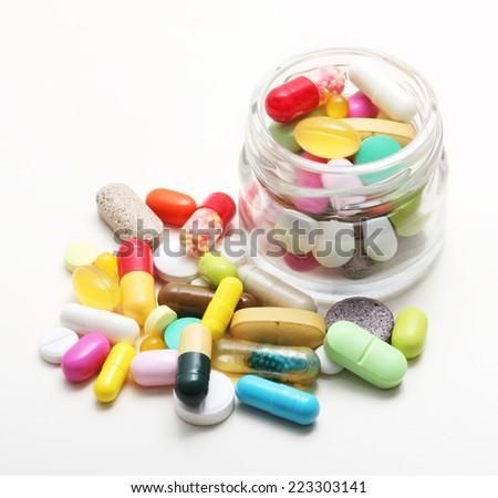 Various pharmaceuticals, pills on white background. - stock photo