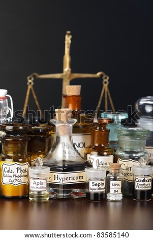 Various pharmacy chemicals of homeopathic medicine, scale in background - stock photo