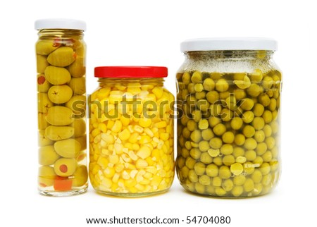 Various pickles in the glass jars on white - stock photo