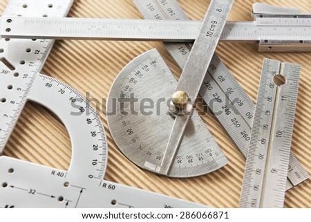 sheet metal measuring tools. various randomly arranged metal measuring tools sheet