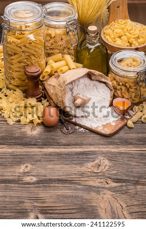Various raw pasta in a glass jar whit pasta ingredients