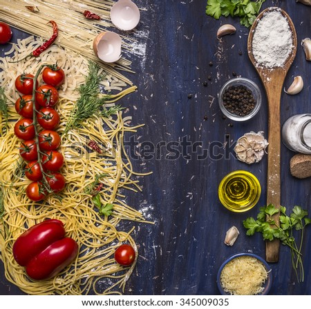 various raw pasta with vegetables and spices, flour and wooden spoon frame with text area on wooden rustic background top view