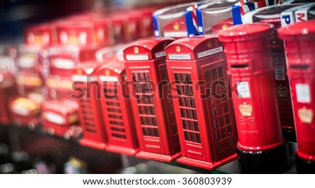 Various red iconic, nostalgic British items for sale in tourist shop.
