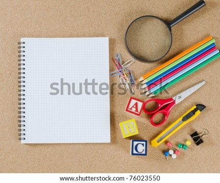 Various school accessories on ���orkboard. School concept - stock photo