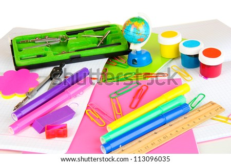 Various school supplies close-up isolated on white - stock photo