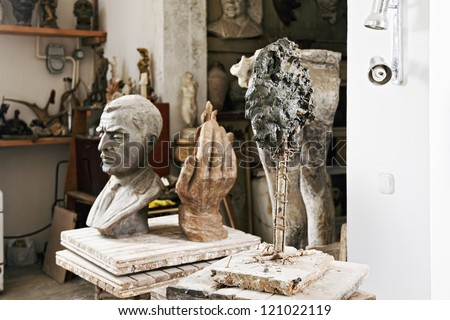 Various sculptures and statues in studio interior - stock photo