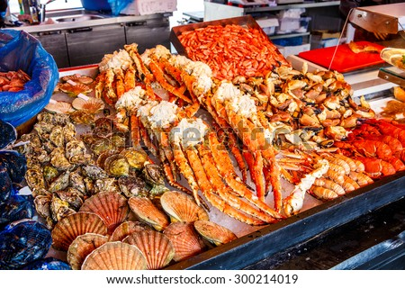 Various seafood on the shelves of the fish market in Norway, Bergen - stock photo