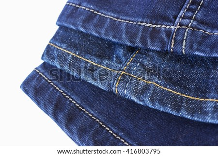 Various seams on blue denim trousers on a white background - stock photo